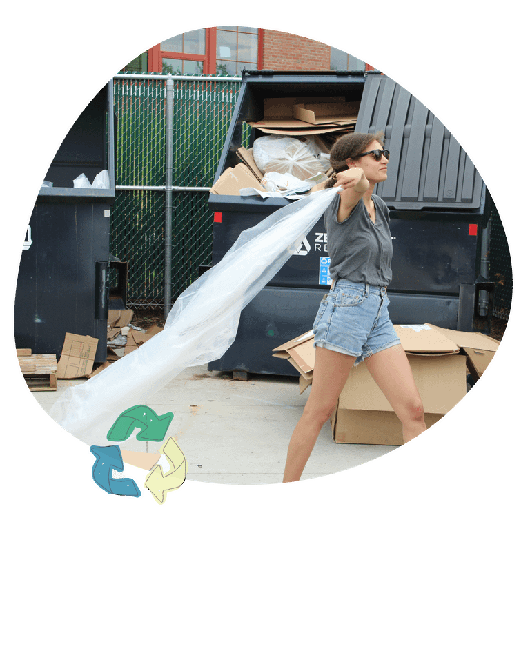 pulling LDPE out recycling dumpster