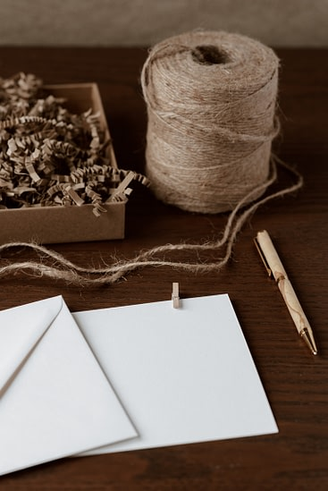 envelopes and twine on a table