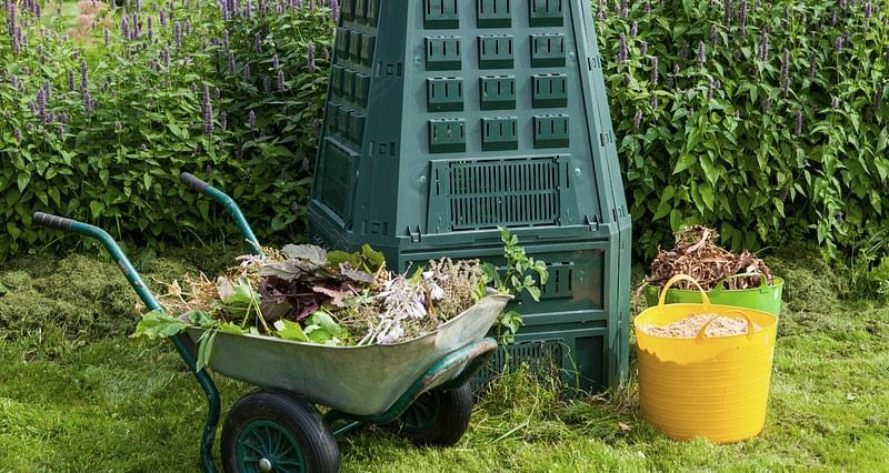composter and wheelbarrow full of garden waste