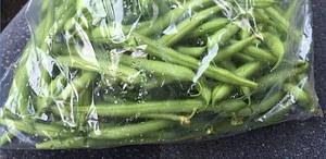 plastic bag of string beans